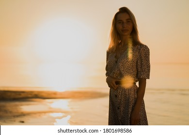 portrait of a young woman walking on the beach. photo silhouette of a girl. the sunset sea. quiet evening