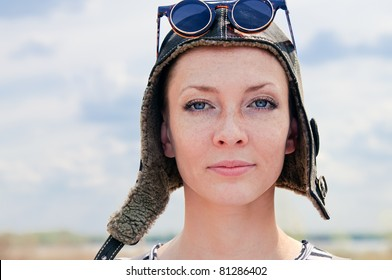 Portrait of Young woman wearing aviator hat