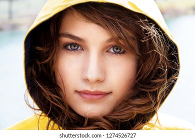 Portrait of a young woman wearing a hooded jacket