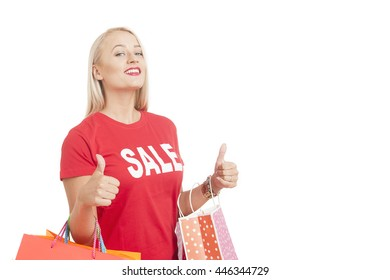Portrait Of Young Woman Wearing Sale T-shirt Holding Shopping Bag