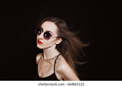 Portrait of a young woman wearing a sunglasses