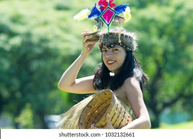 Portrait of young woman wearing traditional Peruvian clothing and dancing Anaconda dance, a musical genre typical of Amazon region of Peru