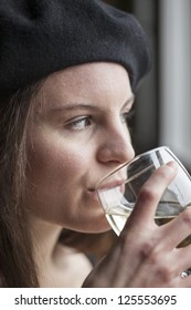 Portrait of a young woman with white wine.