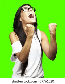 portrait of young woman winning against a removable chroma key background