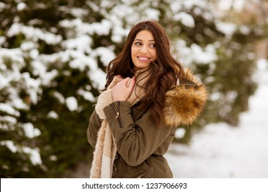 Portrait of young woman in winter park