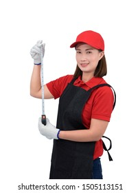 Portrait of young woman worker smiling in red uniform with apron, glove hand holding Measuring Tape isolated on white background with clipping path