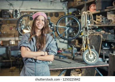 portrait of a young woman worker in a workshop
