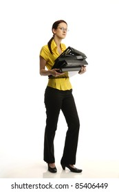 Portrait of young woman in yellow shirt holding files