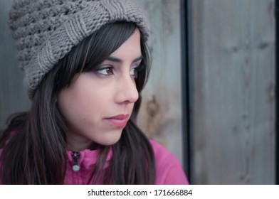 Portrait of a young woman's profile looking lonely