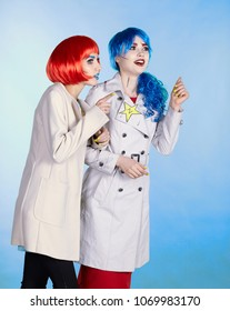 Portrait of young women in comic pop art make-up style. Female detectives investigate a crime