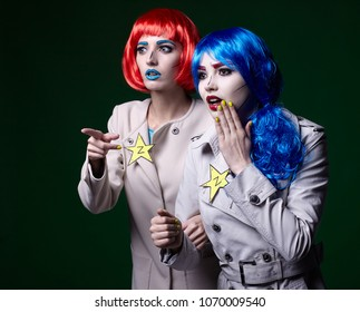 Portrait of young women in comic pop art make-up style on dark background. Female detectives investigate a crime