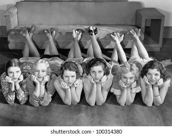 Portrait of young women in row on floor