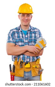 portrait of young worker with crossed arms holding protective gloves smiling and looking at camera isolated