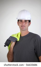 Portrait of a young worker with safety helmet