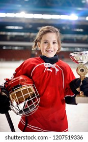 portrait of youth girl player ice hockey winner trophy