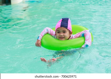 Portraits of Asian girl wearing a swimsuit. Swimming in the pool