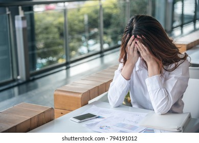 Portraits of beautiful asian woman stressed from work.