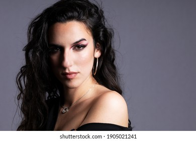 portraits of beautiful woman with black hair on gray background