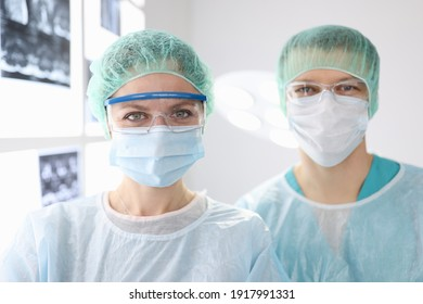 Portraits of doctors surgeons in protective clothing in clinic. Surgical care concept