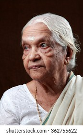 Portraits of an Indian senior woman looking on one side