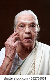 Portraits of an Indian senior woman with a surprised expression