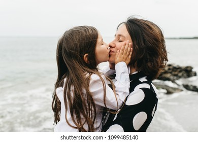 portraits of mom and daughter on the  sea beach