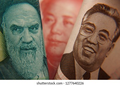 Portraits of political figures of Asian countries, depicted on banknotes. CNY. North Korean Won. Iranian rial. Partially defocused image. For an economical and political themes. Asian money.