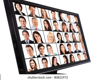 Portraits of smiling people on a computer monitor