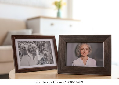 Portraits in stylish frames on table indoors