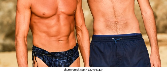 Portraits of two handsome sportsmen body, mature and young men, detail of perfect body on outdoor background. Close. Bright sunlight.