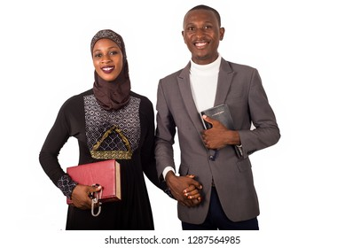 portraits of two religious people holding hands, smiling and holding religious documents.