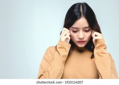 Portraits of young Asian women. Is contemplating, wondering, headache with anxious, not happy, beautiful woman with unconfidence, beautiful on a gray background.