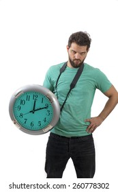 Portraitt of an angry male holding big clock running out of time