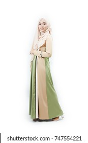 Portraiture of beautiful young Muslim girl wearing Hijab and Jubah isolated over white background.Muslim Fashion.
