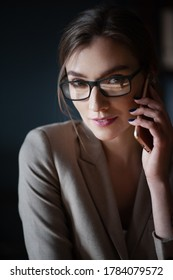Portraiture of businesswomen with glasses from a mobile phone