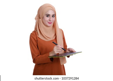Portraiture of confidence Muslim girl smile stand and hold tablet with over white background