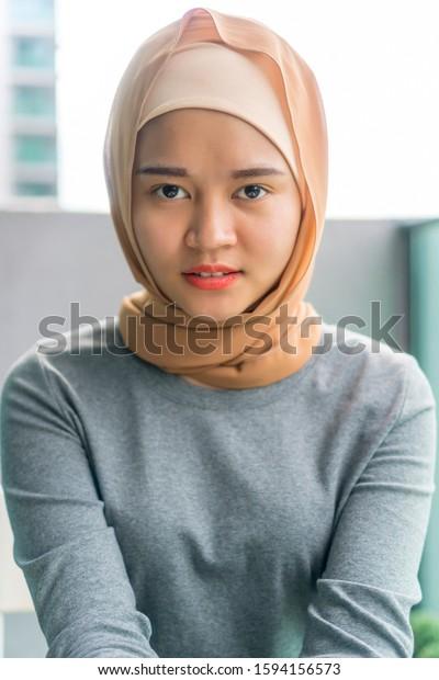Portraiture of cute malay muslim wearing hijab outdoor
