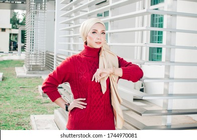 Portraiture of young arabic muslim woman in head scarf smile posing for a camera