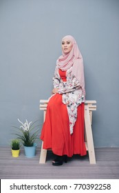 Portraiture of young Asian muslim girl model wearing Hijab.Beautiful Islamic Hijab Fashion indoor photoshoot.