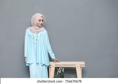 Portraiture of Young Girl Model wearing Hijab.Beautiful Islamic Hijab Fashion indoor photoshoot.