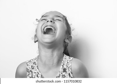 Portrat happy cute smiling child girl. Laughing kid. Black and white image.