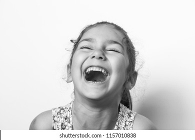 Portrat happy cute smiling child girl. Laughing kid. Black and white image.  - Shutterstock ID 1157010838