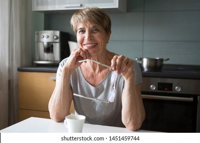 Portret happy senior woman  in kitchen is looking at camera. positive. happy lifestyle concept - Shutterstock ID 1451459744