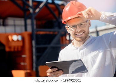 Portret happy worker coal mine in open pit use tablet computer for control quality background yellow truck car. - Shutterstock ID 1994923301