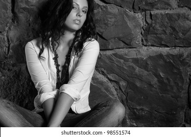 portret model girl on the wall of stone