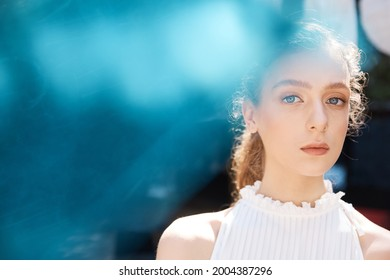 portret photo unusually beautiful girl with big blue eyes and a piercing look - Shutterstock ID 2004387296