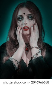 Portret Witch Woman with long hair and holiday dark make-up. Beauty gothic girl. Female character fortune teller, mystic, vampire, magician, wizard. Party Celebrating All Souls' Day body art design - Shutterstock ID 2046966638