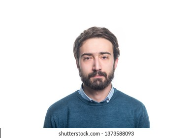 portret of young handsome man with a beard on a white background