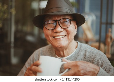 Portriat of  Asian Senoir retirement Man in coffee shop cafe happy lifestyle