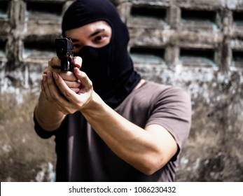 Portriat man with gun shooting, Killer, Gunman.